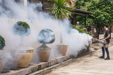 People fogging DDT spray for mosquito kill and protect by control mosquito is a carrier of Malaria, Encephalitis, Dengue and Zika virus in village. 版權商用圖片