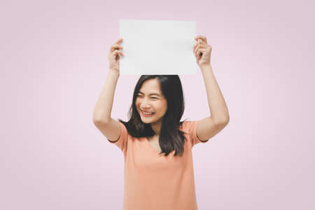 Asian pretty woman showing blank white paper for copy space and message with happy and smile in concept business woman and advertising Imagens