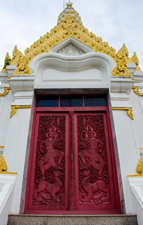 beautiful red door in front of the temple Banco de Imagens