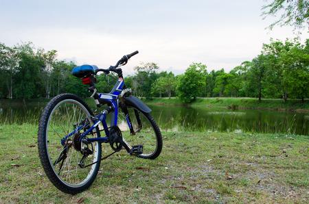 blue mountain bike in the lake