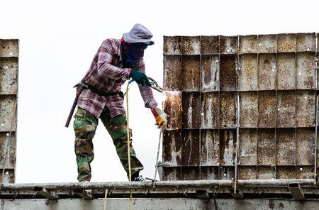 working welder on the unfinished building Banco de Imagens