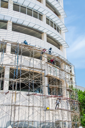 work worker workforce world: scaffold at the constructed building Stock Photo