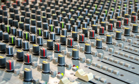 Closeup shot of audio mixer in recording studio photo