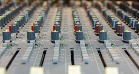closeup shot of audio mixer in recording studio photo