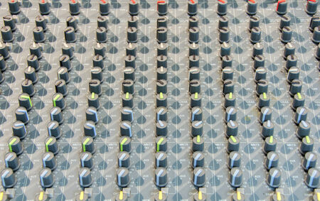 Closeup shot of audio mixer in recording studio