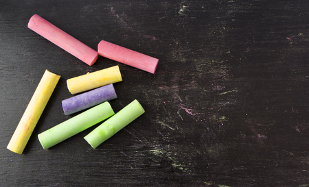 colorful chalks on blackboard background. Stok Fotoğraf