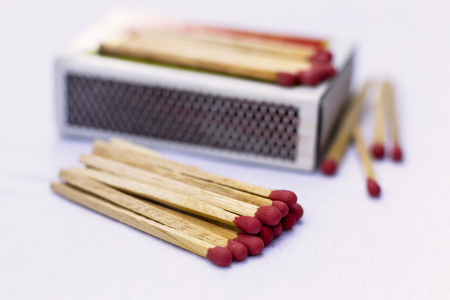 Box of matches on a wooden table, shot at close-up Stock Photo