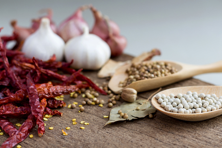 peppercorn: Food ingredients, peppercorn and red dry chilli peppers on wooden table, asian food cooking concept. Stock Photo