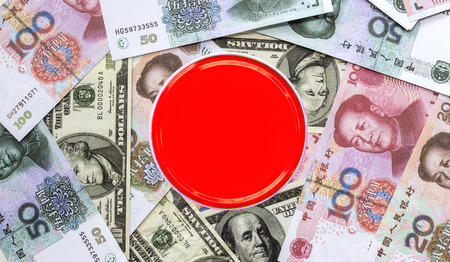 Dollar banknote and yuan banknote on the table. The concept of business growth, financial or money savings. with copy space for text. Stock Photo