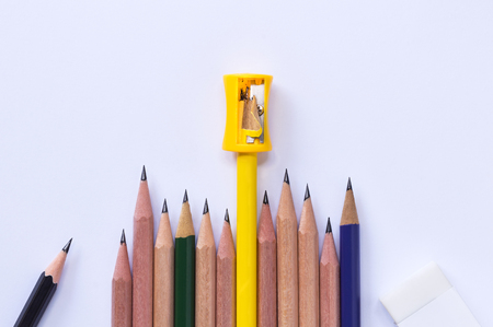 pencil-sharpener, eraser, and many pencils isolated on white paper background. with copy space for your text.