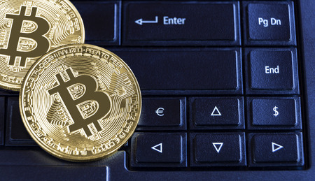 Bitcoins on the keyboard laptop computer. Virtual money or cryptocurrency concept. with copy space for your text. 版權商用圖片