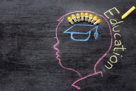 Children's sketches aimed at success on a chalkboard with chalk. The concept of intelligence comes from education and back to school.