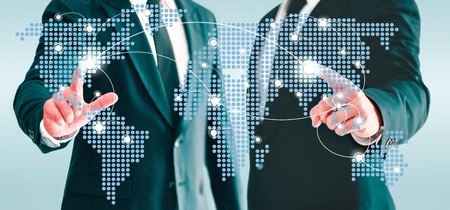 Two businessmen touching world map virtual button. Concepts of information and business contacts interconnected world.