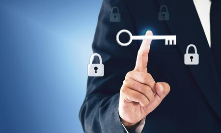 Businessman touch a virtual key that represents the discovery of victory or success in business.