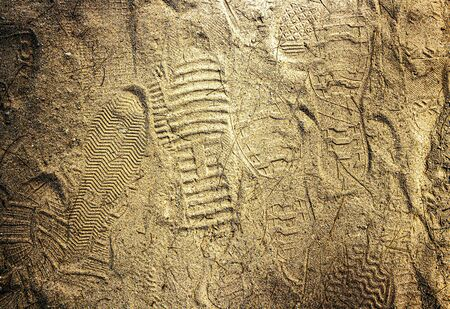 There are traces of various soles on the beach. Stock Photo