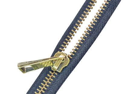 Old brass zipper isolate on a white Banque d'images