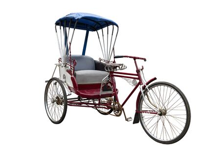 Old tricycle isolated on a white