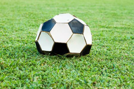lint: broken ball on grass field Stock Photo