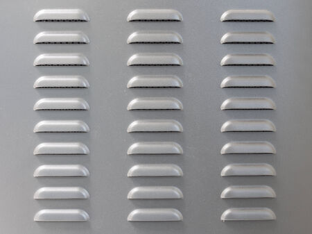 vent: Metal surface with air vent perforation Stock Photo