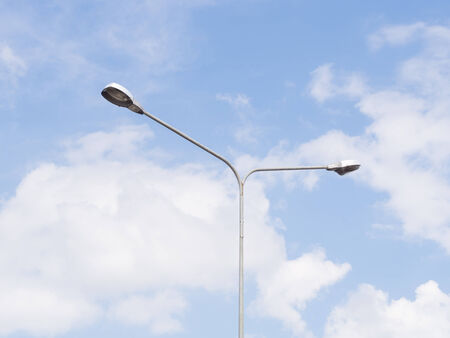 electric avenue: Street light over blue sky Stock Photo