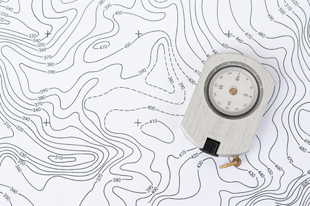 Compass on Topographic Map. Stock Photo