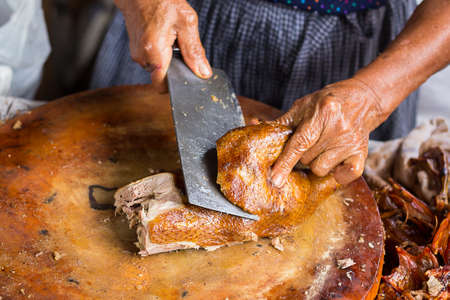cut through: knife cut through the roast chicken Stock Photo