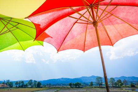 umbella: umbrella, red umbrella with rice field and blue sky