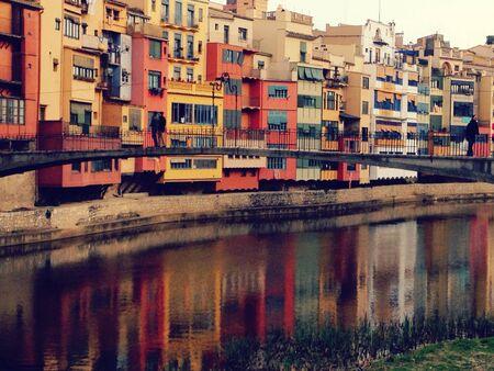 View of a bridge over colored building facades