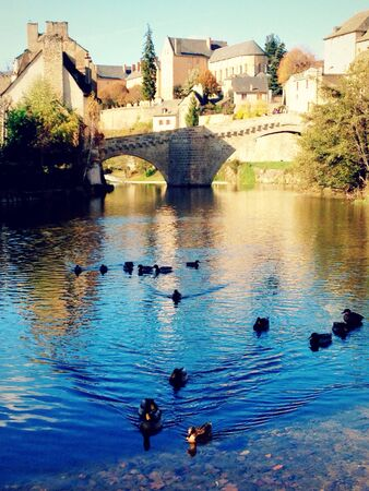 Old town and stone bridge by the river in France