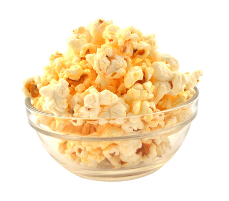 Bowl of fresh popped popcorn isolated on white background photo