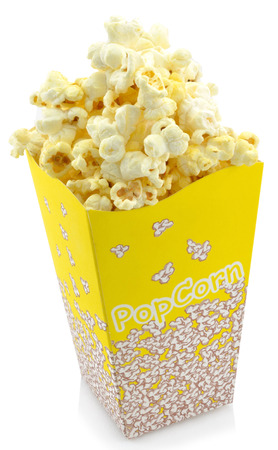 Bowl of fresh popcorn isolated on white background photo