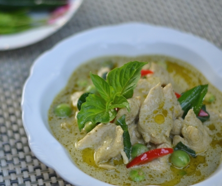 Green pork Curry on green leaf , Thai cuisine photo