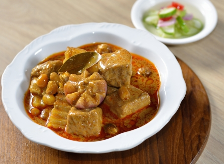 Thai food pork mussaman curry with sauce photo