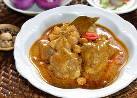 Thai food chicken mussaman curry with spices photo