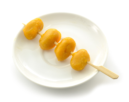 sweetmeat: Pinched gold egg yolks on white background Stock Photo