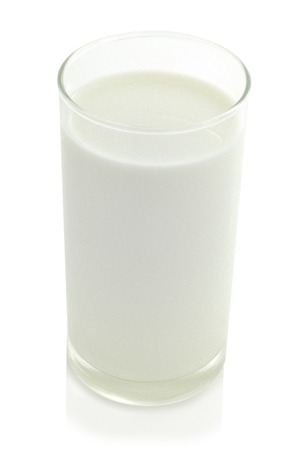 milk in the glass on white background photo