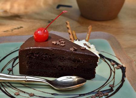 Dark chocolate cake with cherry Stock Photo