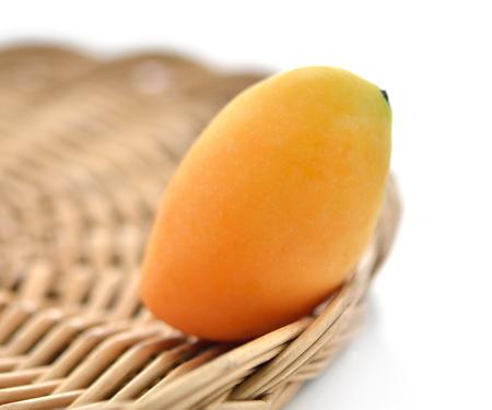Sweet Marian plum fruit in basket on white background