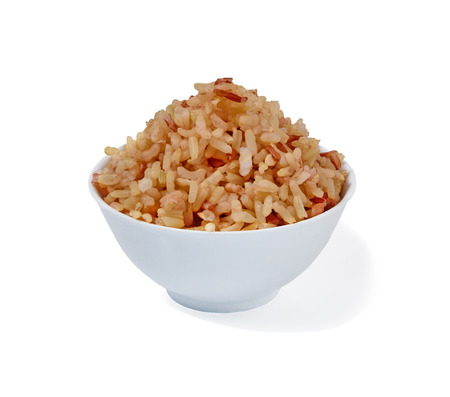 cooked brown rice on white background Stock Photo