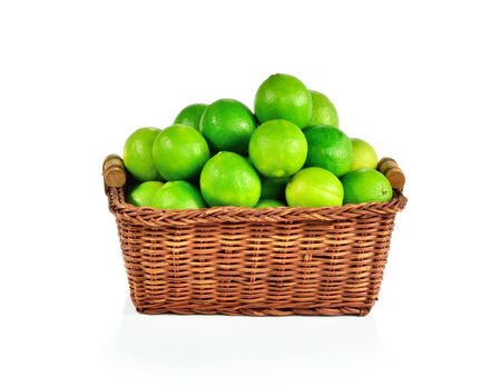 Fresh limes in basket white background