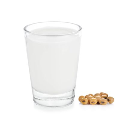 glass of milk and Soybean on white background