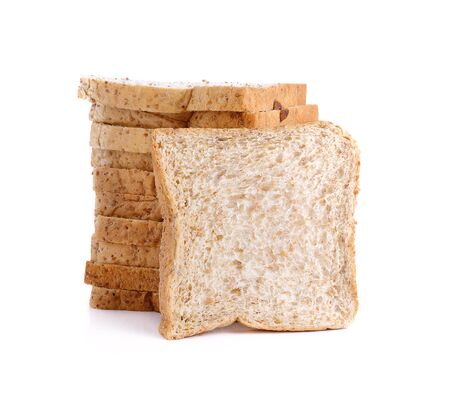 Sliced whole wheat bread on white background Stock Photo