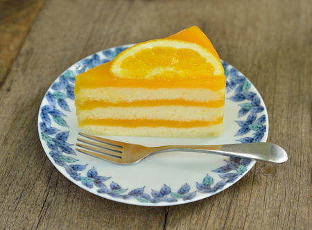 Orange cake on wooden background Stock Photo