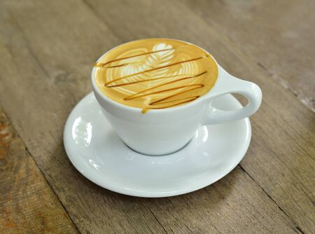 Coffee latte art on wood table Stock Photo