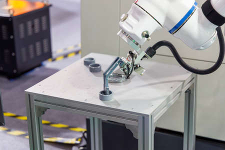 Robot arm is picking up work part, Robot industrial, robotic clamp arm.