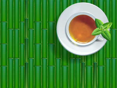 Cup of black tea with leaves, top view on bamboo background.