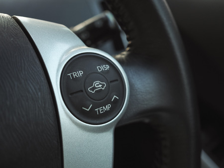 driving conditions: temp control button in car