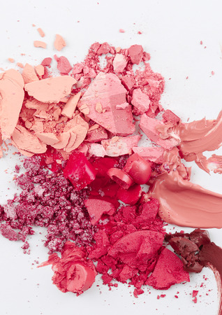blusher: smudged of cosmetic, lipstick powder blusher and foundation