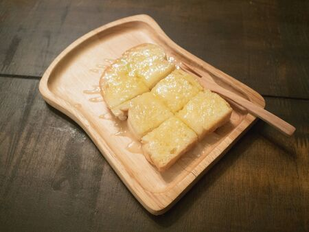 buttered: buttered toast with wood tray Stock Photo