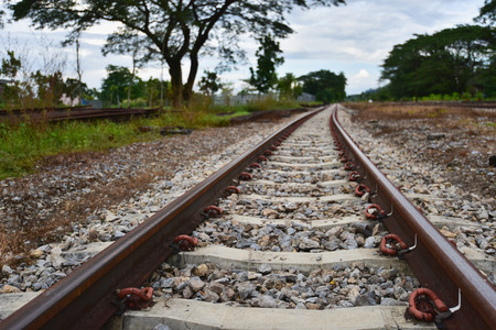 infra construction: old rial of vintage train in thailand